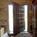 Pintle-hinged front entry made from reclaimed Douglas fir