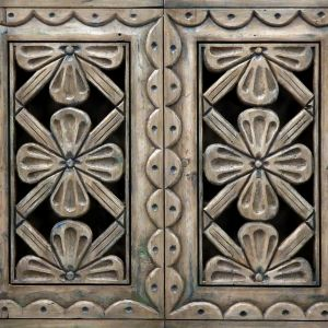 Hand carved door panels in Santa Fe home bar