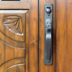 hardware detail on arched door in surround