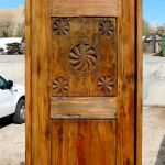 Powder room door with antique carved panel