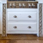 Stove cabinet with inset antique carved panels