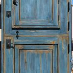 blue Dutch door with cast deadbolt