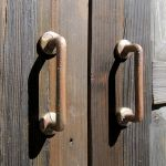Handles on cabinet with abstract floral clavos