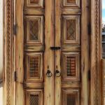 doors with carved panels and antique hasp