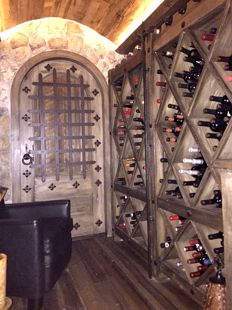 installed arched wine cellar door