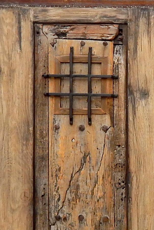 Custom grilled peep door in gate