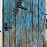 iron dragonflies on gates