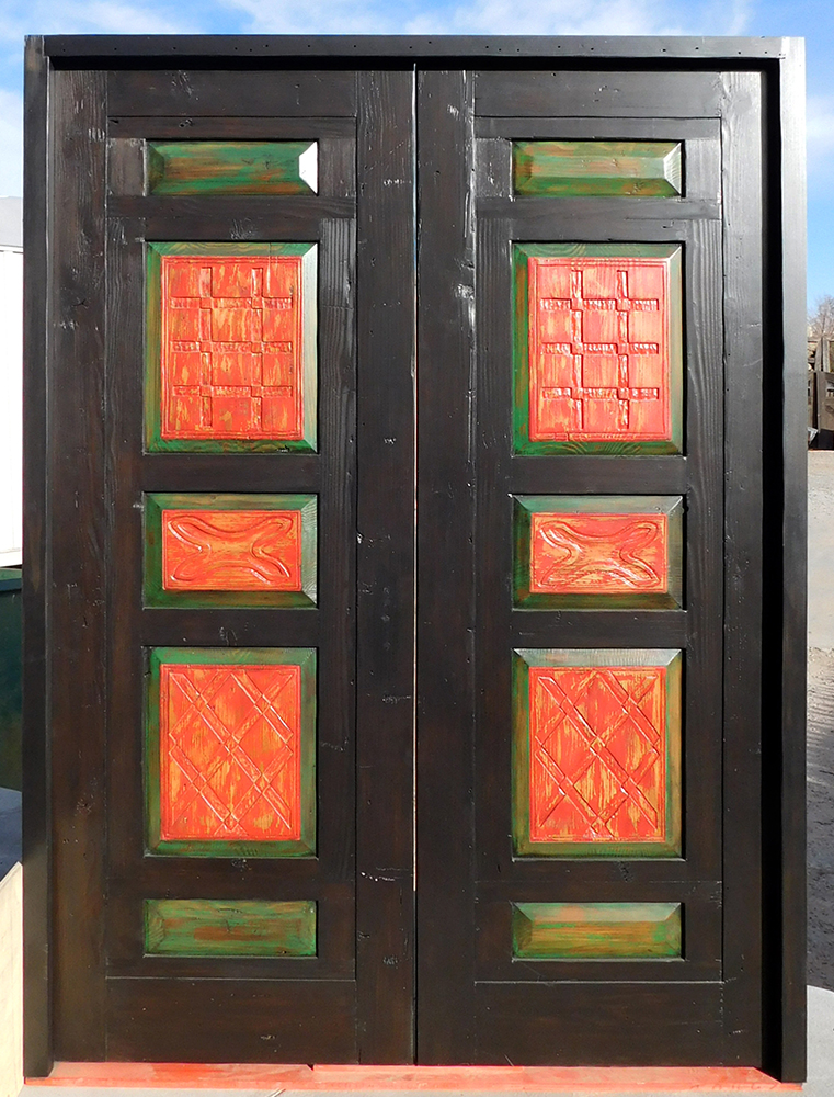 Custom bedroom doors with carved panels