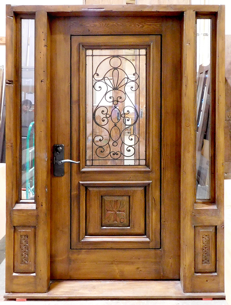 Front door with sidelights and antique carved panels