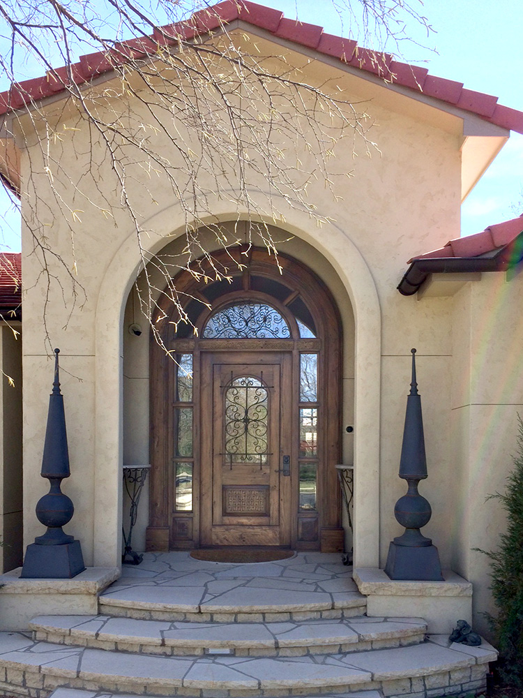 Front door with arched surround