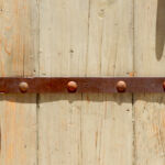 antique strapping on bath entry