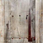 Tin patching and clavos on rustic front entry