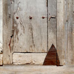 Tin patching on rustic front entry