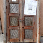 Antique cupboard doors used to make double gate