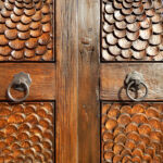 Detail of hand carved doors and hardware