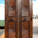 Hand carved closet doors on the loading dock
