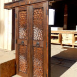 Carved closet doors with lintel