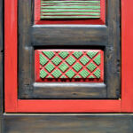 Carving and finish detail on colorful front entry