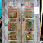 Antique cabinet doors used to make colorful front entry