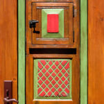 Detail of finish and carving on colorful front entry