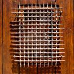detail of grillwork on pintle-hinged door