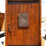 Finished pintle-hinged door