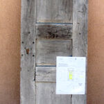 antique Mexican mesquite door used to make gate with grilled peep