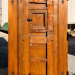 Back of gate with clavos and L-strapping